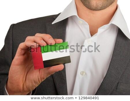 Businessman holding business card with United Arab Emirates Flag Stock photo © stevanovicigor