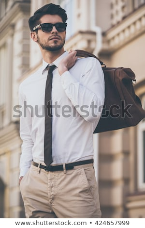 outdoor fashion man with bag in hand stock photo © feedough