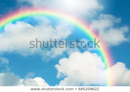 Background with sun, clouds, rainbow and rain Stock photo © kali