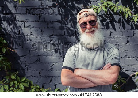 Senior man showing smiley face Stock photo © bmonteny