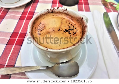 beautiful view of rome and cup with cafe latte stock photo © tannjuska