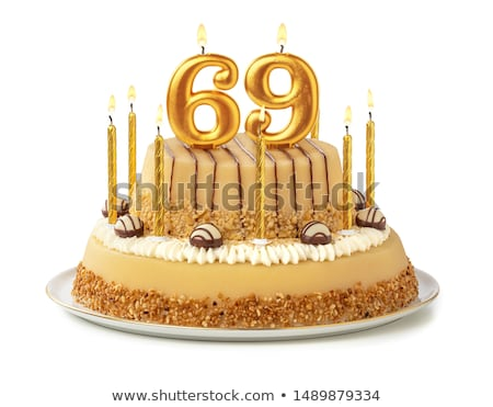 Birthday cake with burning candle number 69 Stock photo © Zerbor