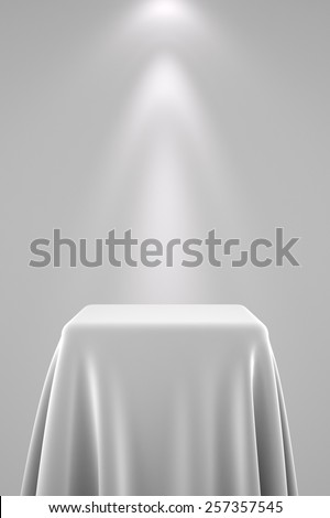 Pedestal with white silk cloth and spot light Stock photo © creisinger