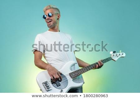 Elektromos basszus gitár játszik izolált fekete Stock fotó © italianestro