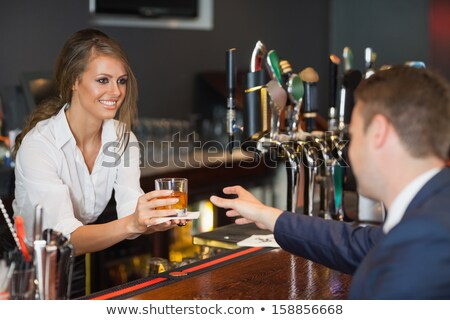 young waitress with beer on white stock photo © elnur