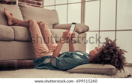Woman Using Her Mobile Smart Phone at Home Stock photo © maxpro