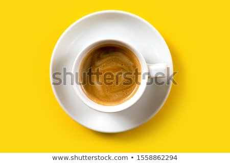 Yellow cup of coffee on a white table Stock photo © CaptureLight