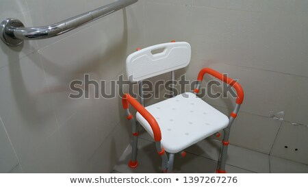 Old wheelchair in corner of room Stock photo © backyardproductions