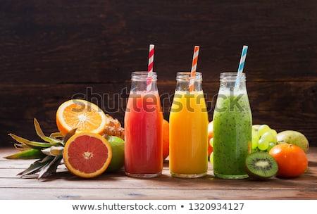 Still-Leben orange Früchte Saft Flasche Glas Holztisch Stock foto © dariazu
