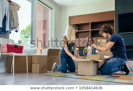 Woman on a chair, toolbox on the floor Stock photo © IS2