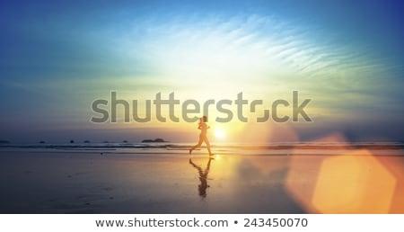 若い女の子 · を実行して · ビーチ · 笑みを浮かべて · 子 · 冬 - ストックフォト © is2