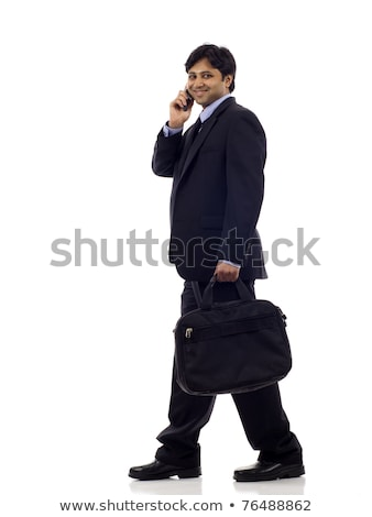 Indian man with suitcase talking on phone Stock photo © studioworkstock