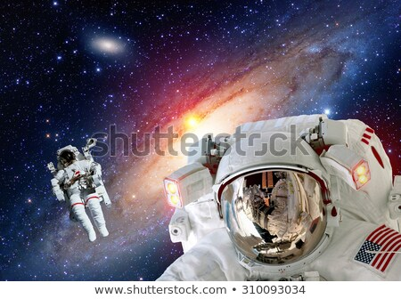 Two astronauts exploring on strange planet Stock photo © colematt
