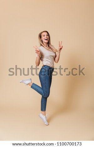 Full length image of joyous woman 20s wearing casual clothing sm Stock photo © deandrobot