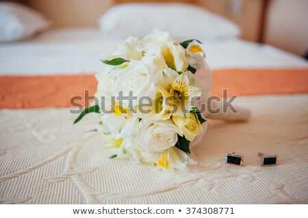 bridal bouquet with male studs on the bedspread Stock photo © ruslanshramko
