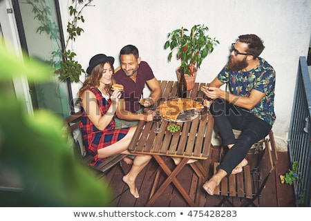 Stock photo: happy friends with takeaway food outdoors