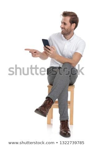 Sentado hombre teléfono puntos dedo Foto stock © feedough