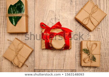 Open Red Gift Box and Confetti. Christmas and Valentine Background. Vector Illustration Stock photo © olehsvetiukha