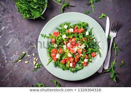 Fresh summer watermelon salad with feta cheese and arugula Stock photo © Illia