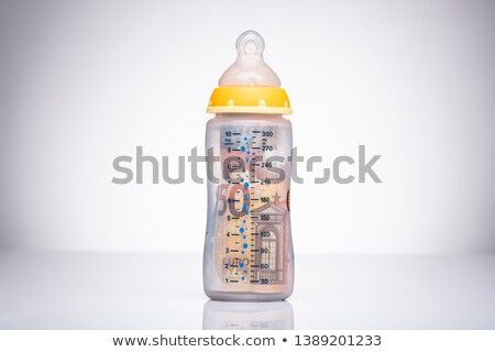 Euro Bank Notes In The Milk Bottle Stock photo © AndreyPopov