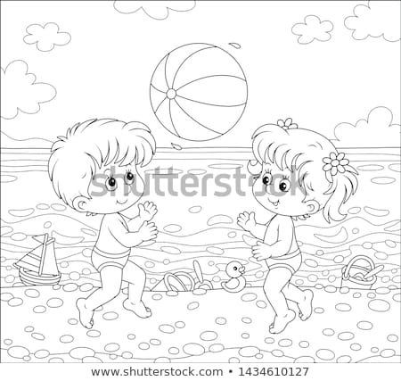 Toddler Girl Playing With Ball Near The Seashore On Beach Stock photo © AndreyPopov