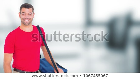 Delivery man with blue bag against blurry office Stock photo © wavebreak_media