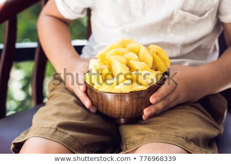 Fiú eszik ananász terasz kezek étel Stock fotó © galitskaya