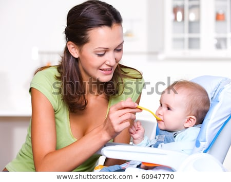 anya · etetés · kicsi · lánygyermek · nő · lány - stock fotó © lopolo