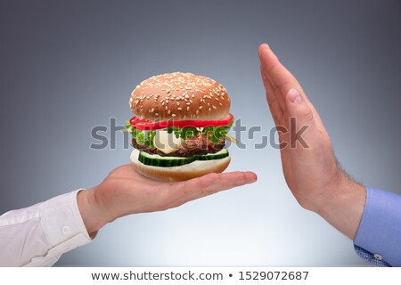 Man's Hand Refusing Burger Offer By Other Person Stock photo © AndreyPopov