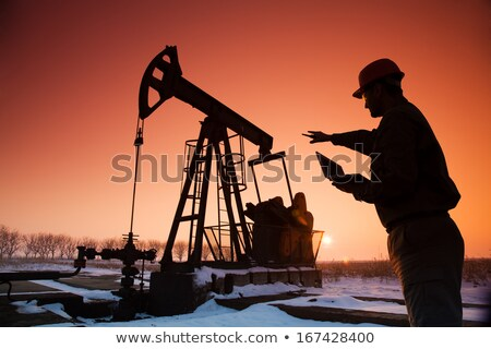 Silhouette of oil workings out stock photo © mayboro
