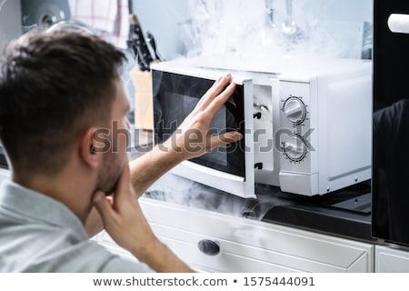 человека глядя огня микроволновая печь печи молодым человеком Сток-фото © AndreyPopov