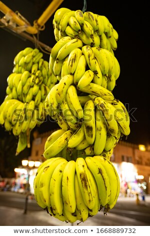 Ripe Egyptian bananas suspended by a large bunch outside the store. Stock photo © ElenaBatkova