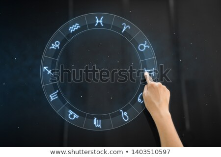 hand using interactive panel with signs of zodiac Stock photo © dolgachov