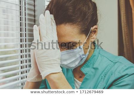 Kimerült orvos csukott szemmel arc maszk kórház Stock fotó © CsDeli