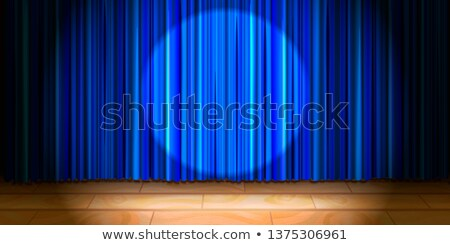 Empty beige wooden stage with blue curtain drape and round spot light Stock photo © evgeny89