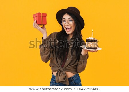 Kép ázsiai barna hajú nő tart születésnapi torta Stock fotó © deandrobot