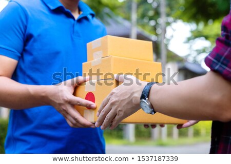 Courier with Box in Hands, Delivery of Product Stock photo © robuart