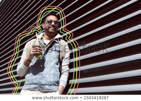 Férfi hátizsák iszik smoothie utca utazás Stock fotó © dolgachov