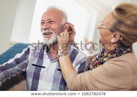 Hallókészülék közelkép kilátás kéz idős nő Stock fotó © lisafx