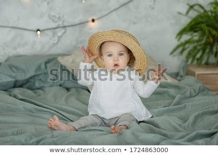 fiatal · lány · mosolyog · guggol · lány · állat · Európa - stock fotó © lithian
