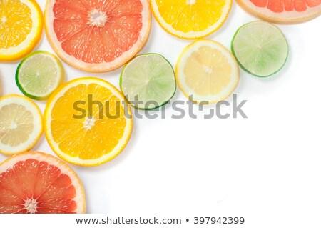 Lemon, grapefruit, orange and lime slices isolated on white back stock photo © tetkoren