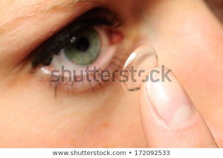 Stock fotó: Portré · fiatal · nő · visel · kék · kontaktlencsék · stúdiófelvétel