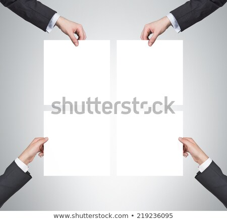 Stockfoto: Businessman Is Holding Board With Question Signs