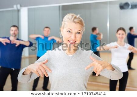 starsza · kobieta · sportowe · piękna · pracy · kobiet · biały - zdjęcia stock © photography33