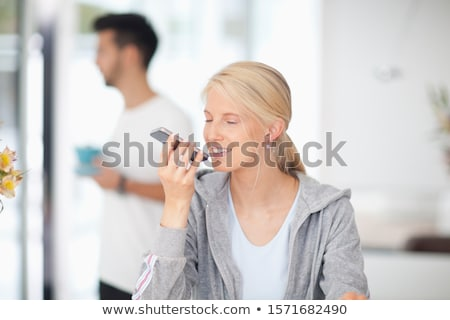 Blond woman wearing hooded top Stock photo © photography33