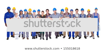 Electrician pointing a white sign for message Stock photo © photography33