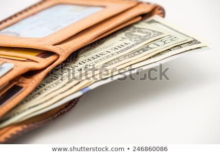 stealing cash out of wallet stock photo © gewoldi