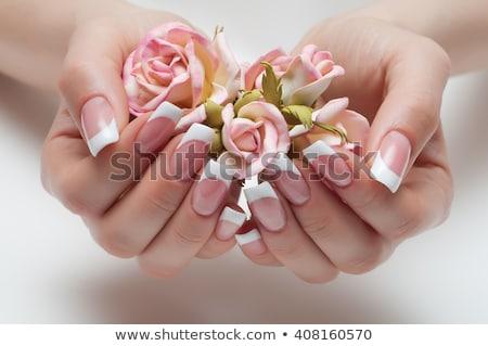 Francia manikűr gyönyörű kezek fekete virág kéz Stock fotó © vlad_star