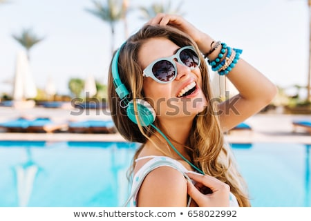 Laughing woman relaxing in a pool Stock photo © dash