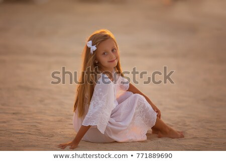 young girl in the tunic at the beach Stock photo © g215